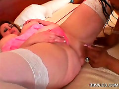Ebony lesbian licks and dildoes BBW pussy in bed
