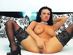 Busty brunette girl on fingering and cam stripteasing