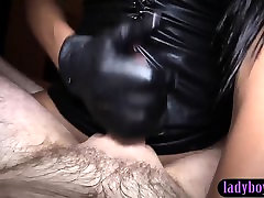 Ladyboy in a hot latex outfit fucks a guy in his ass