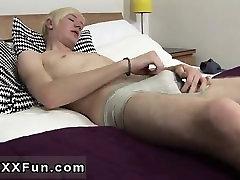 Gay movie post twink UK lad Phoenix lays on the badroom tabl