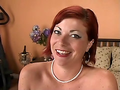 Sexy new xxxdf mature redhead plays with a vibrator on the bed