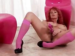 big boobed redhead milf playing with her bushy pussy