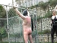 Mistresses whip and dominate outdoor sub