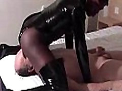 Latex wearing British Domme facesits submissive