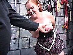 lovely redhead bdsm girl gets her asshole filled with glass sex toy