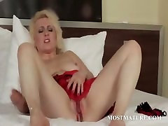 Blonde granny slim doggy spreads wide her pussy