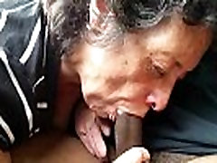 Mature lady sucks a black shaft