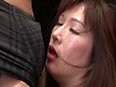 Oriental milf likes sucking balls