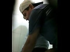 4280549 two men jerking in toilet
