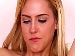 Blonde inserts fingers into pussy