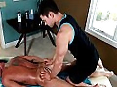 Horny masseur rims dude on massage table