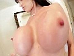 Busty mature brunette sucks on cock