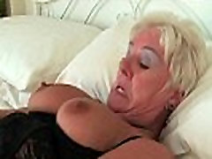 Chubby granny in black stockings masturbates