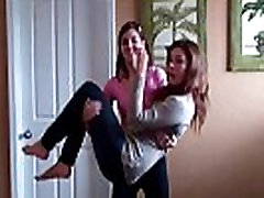 Two femdom mistreses lift carry each other