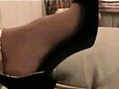 Amateur showing her stilettos and stockin feet