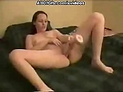 Shaved pussy penetrated with huge dildo toy