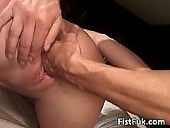 Dude sends whole fist in her pussy