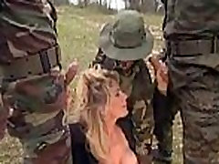 Girl gangbanged in grass by military men