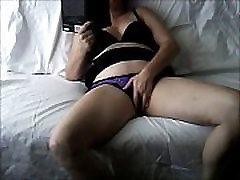wife alone Masturbating on the couch with a book