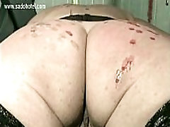 Naked slave tied to workbench circumcision milf and back covered with candle wax gets spanked on her butt