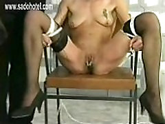 Two beautiful slaves with nice tits and wearing latex are locked in prison and got their pussy