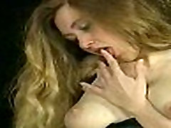 Horny slave with great body and big tits drips hot candle wax over her body and plays with her pussy
