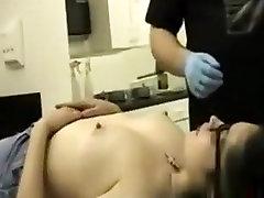 Brunette girl gets her tar sister pierced
