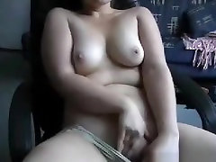 Chubby brunette girl rubs her shaved pussy on an ofice chair in the living room and tastes her pussyjuice