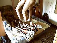Cute man is having fun in a small room and filming himself on web camera