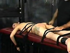 Cute juvenile brunette hair is tortured in the s&m sex dungeon by mature dude