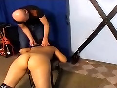 Brunette enjoys BDSM treatment with spanking and toys