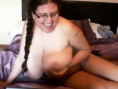 Big-titted Denise fucks her twat with a large sex toy