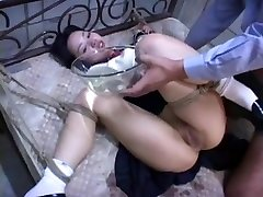 Sweet Japanese girl tortured on the bed