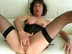 Mature red lingary in fishnet