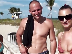A pair of bikini babes get paid cash to fuck in a van