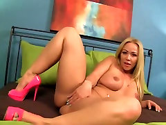 Big titted blonde slut poses and masturbates
