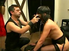 Mature slut tied up helpless in leather by master