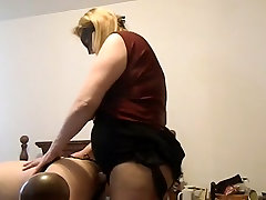 Sexy cili paki MILF fucking a man with a huge strap on