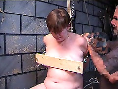 Overweight woman receives her love muffins nailed in wood in dungeon play with un jeunne avec famme velle dom