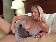 Big-titted MILF seen masturbating