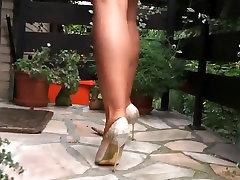 Classy lady strolling through berlin in high heel stilettos