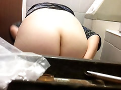Big mature butt caught on a sitting on a toilet