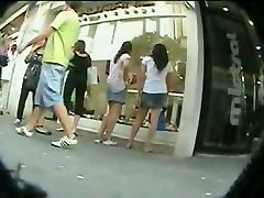 Asian sluts get upskirted by a real public voyeur in the shopping center
