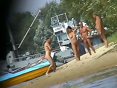 Hot family silent voyeur video shows mature nudists enjoying each others company.