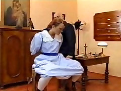 European vintage spanking scene with a teen brunette