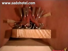 Villein cum-hole nailed on wood with needles and nails.