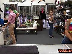 Asian girl gives pawn man a happy girl teak at the pawnshop
