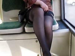Girl flashing black stockings in a bus