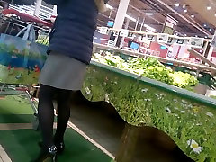 Milf Nice legs with up close pussy cream doing shopping