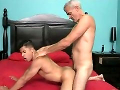 Gray-haired man fucks young point